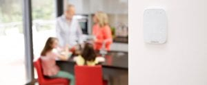 alarm keypad on wall family in kitchen