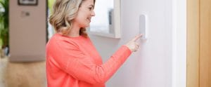 woman-at-house-alarm-system